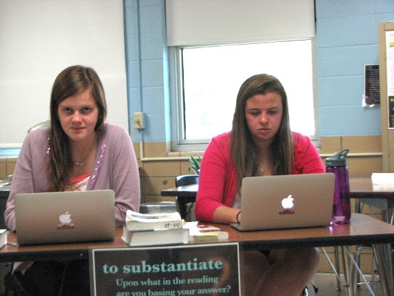 Seniors Moriah Cooper and Jessica Harvey use their laptops in class