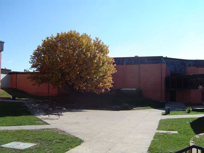 The courtyard stands empty on a sunny day.