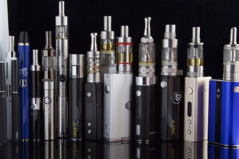Pic Credit: Jon Williams A line of different types of Vapes. Most consist of a bottom battery (tank) and a top tank that holds various flavored juices.