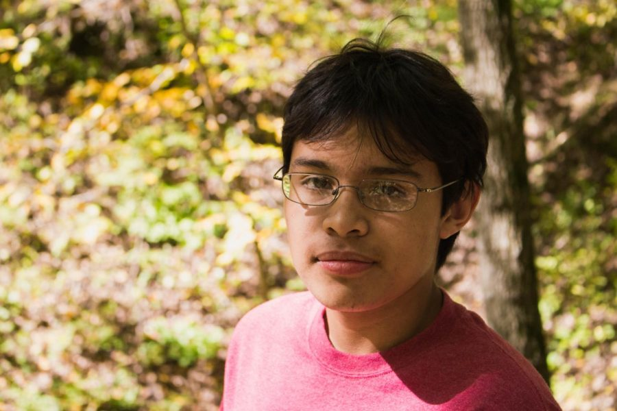 Andres poses for a photo in Ledges state park, one of his favorite nature retreats.