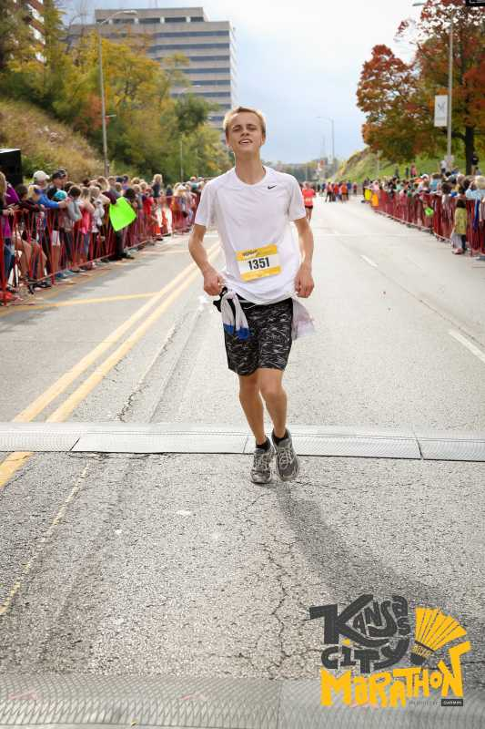 Michael Holm crosses the finish line at 4 hours and 50 minutes.