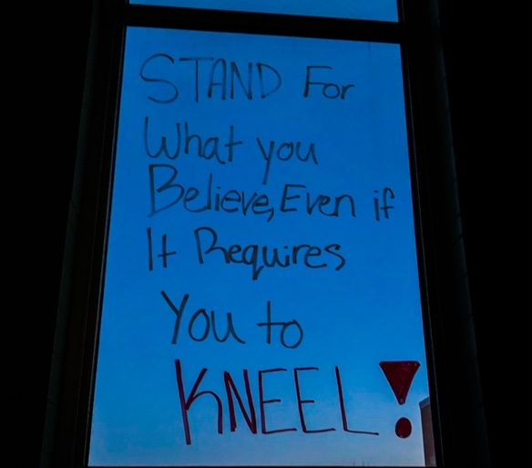 Image of messages written on the windows for Black History Month.